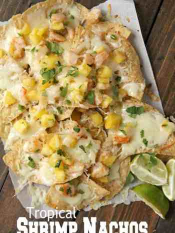 shrimp nachos with lime wedges