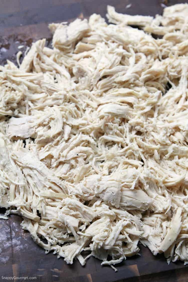 shredded chicken on cutting board