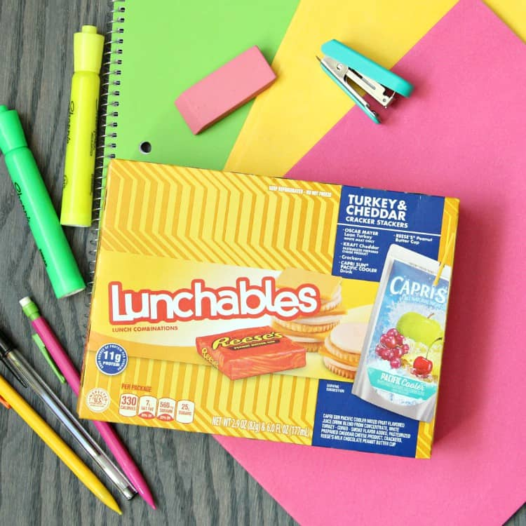 Box of Lunchables and school supplies