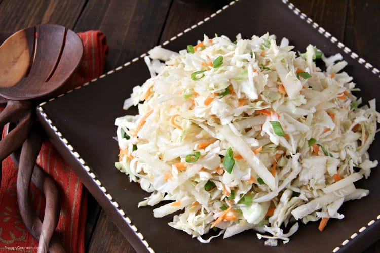 Asian slaw on brown plate and napkin