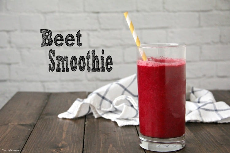 beet smoothie in glass on table