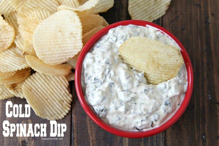 spinach dip in bowl with chips