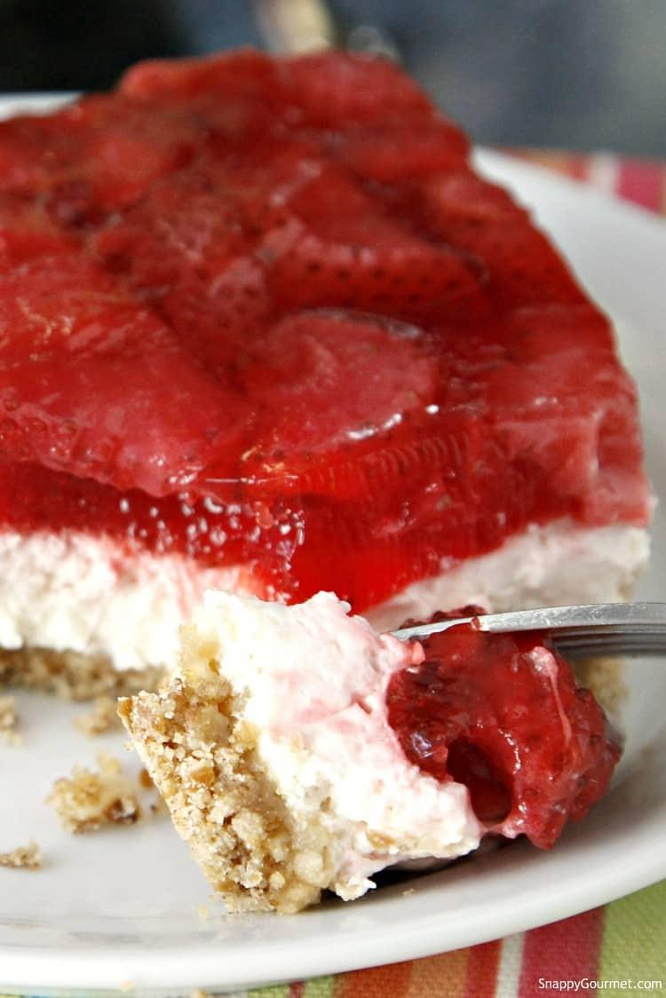closeup of Strawberry Pretzel Dessert Bars with fork
