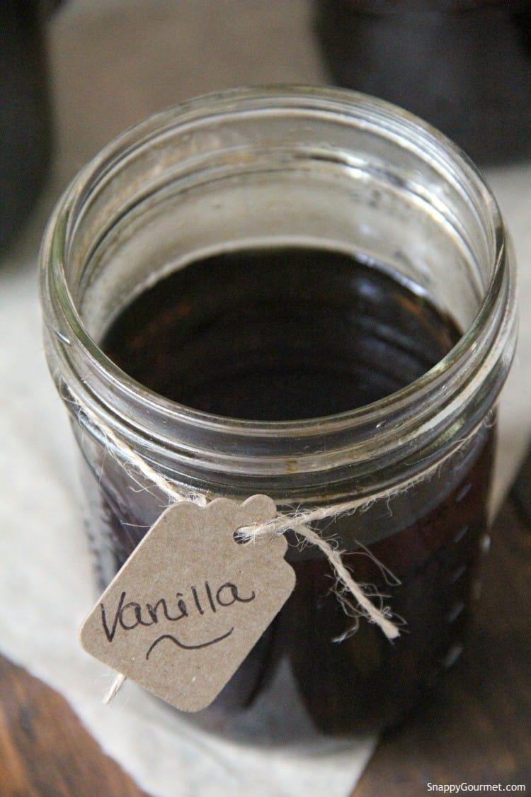 closeup of homemade vanilla extract and gift tag