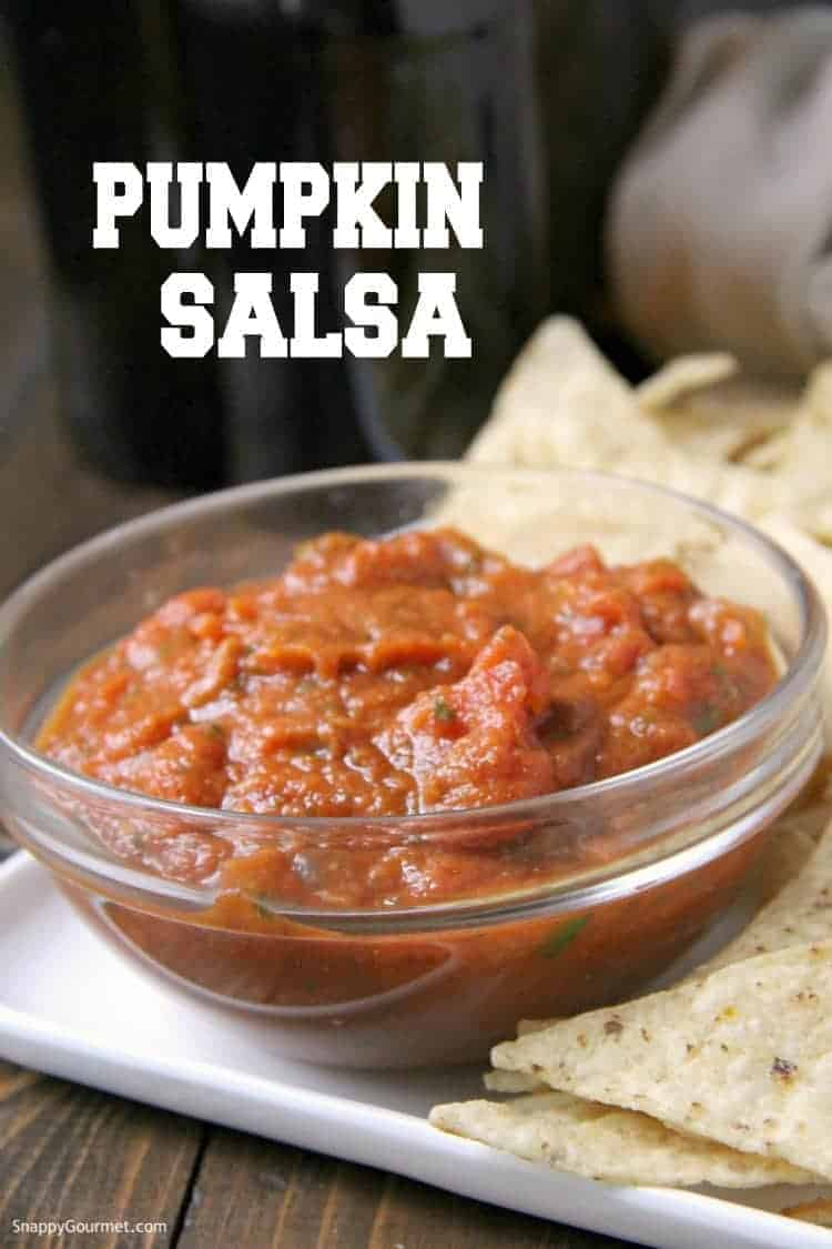 Glass bowl with pumpkin salsa and chips