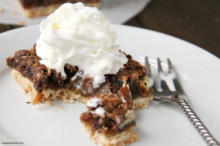 pie bar cut open with whipped cream on top
