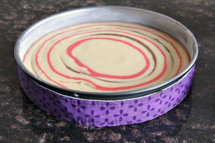 striped cake batter in cake pan