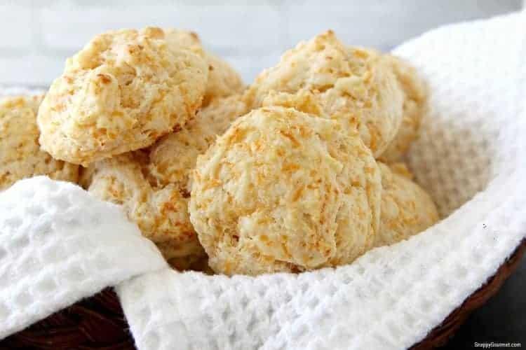 big soft biscuits on towel in basket