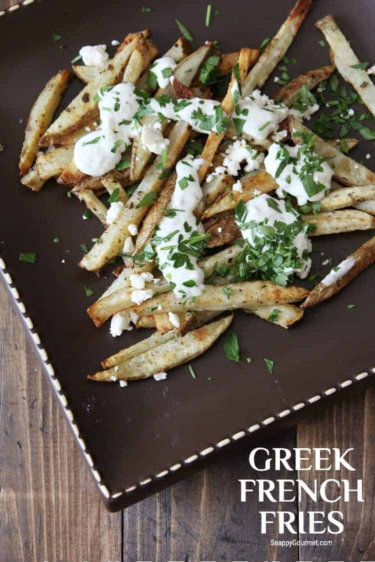 Greek Fries with tzatziki, feta cheese, and parsley on plate