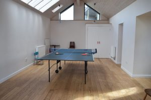 ping pong table in games room with wooden floor hartpiece devon