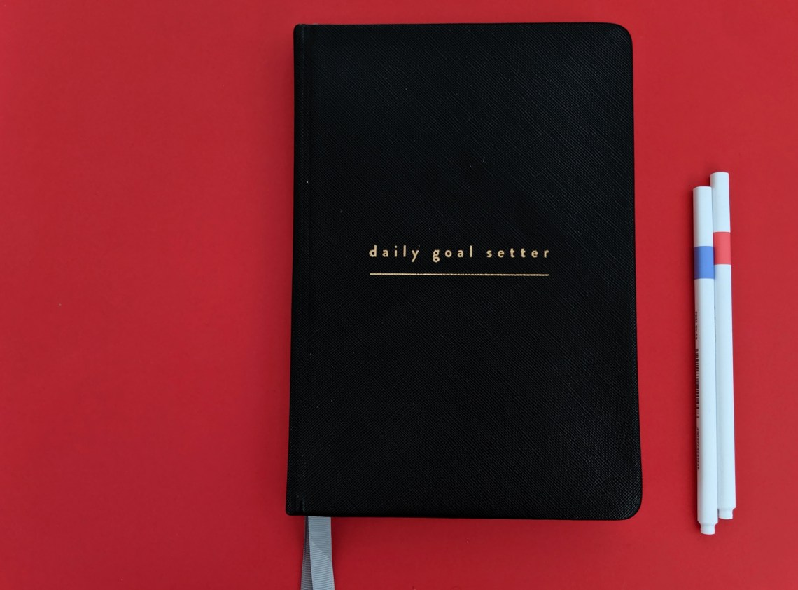 front cover of black goals planner