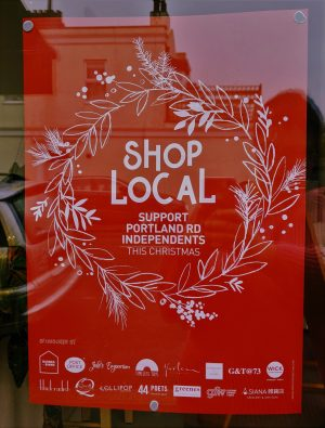 poster displaying text of local shops and the slogan of shop local portland road hove