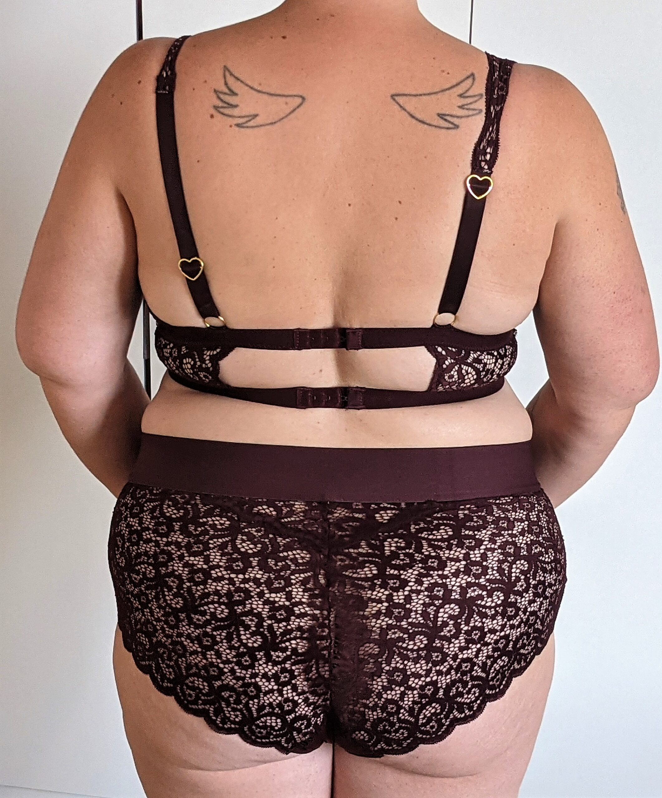 plus size lingerie from behind. lace bralette and briefs