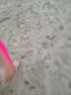 Foot walking on sand