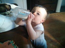 standing_holding_bottle