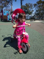 outside_pink_dress_tricycle