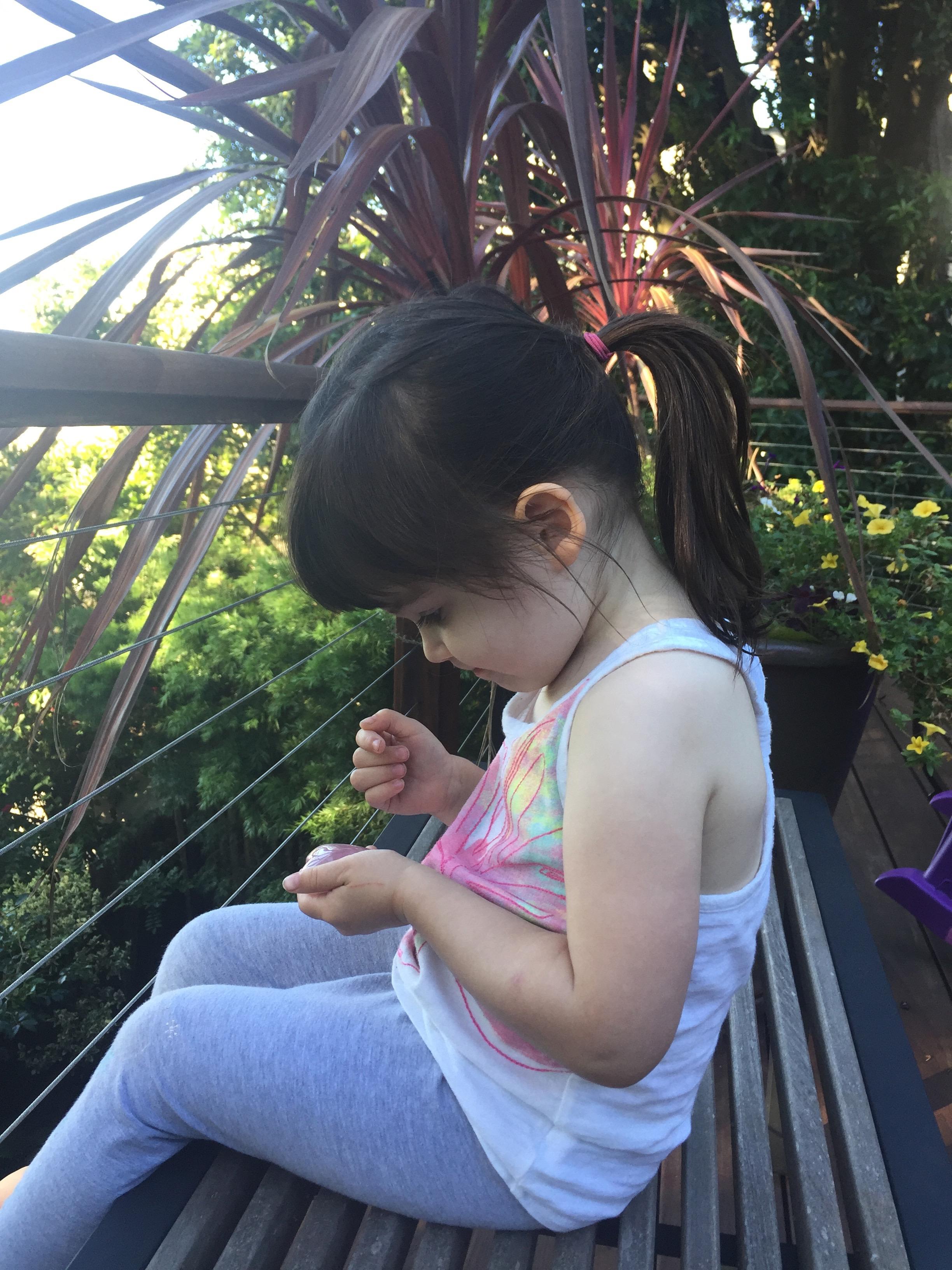 sitting_on_back_deck_ponytail