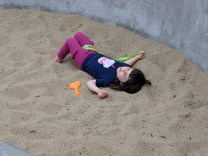 playground_sandbox_lying_down