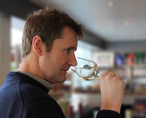 Paul Liversedge MW nosing a wine