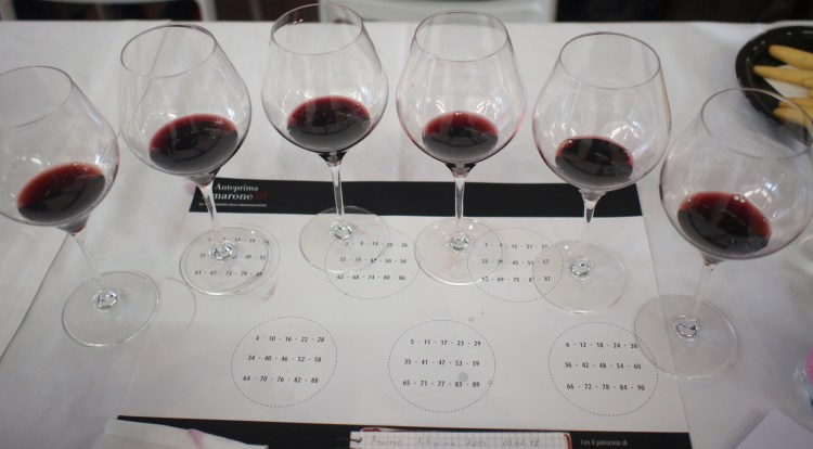 Six tasting glasses with Amarone 2014 vintage at the Anteprima amarone