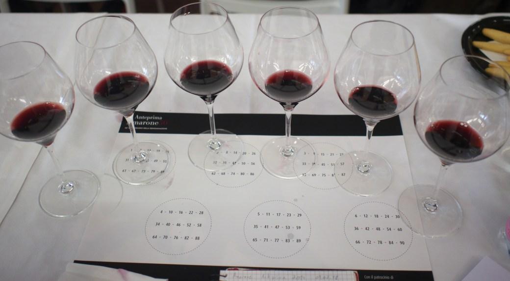 Six tasting glasses with Amarone 2014 vintage at the Anteprima amarone