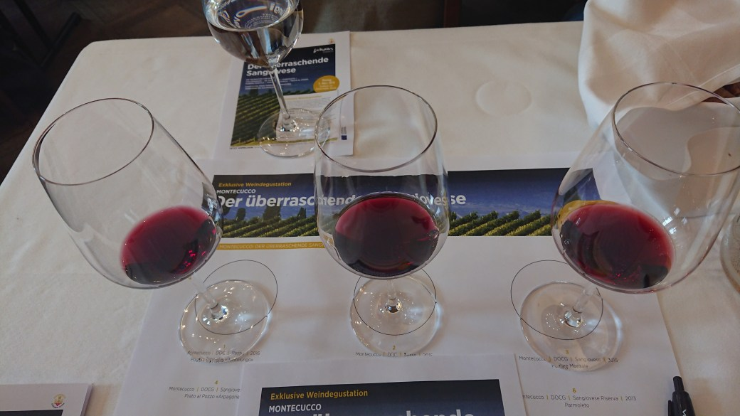 Three tasting glasses with wines from Montecucco