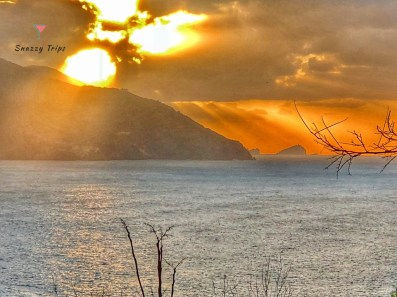 Sunset over mountain and sea