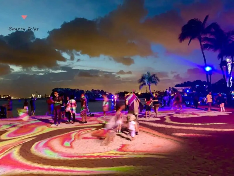 swirling patterns on beach at night in Singapore