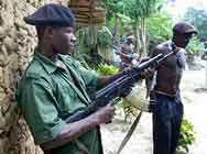 Rebel faction standing guard in Okoronta village in the Niger Delta, July 2004