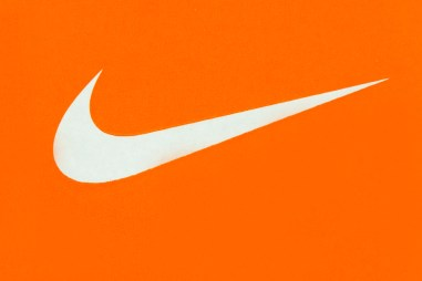 ナイキ ロゴ (White Nike Logo on Orange Background;Nike, Inc.)