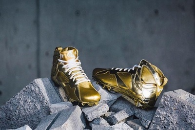 charles-woodson-air-jordan-7-gold-cleats.jpg