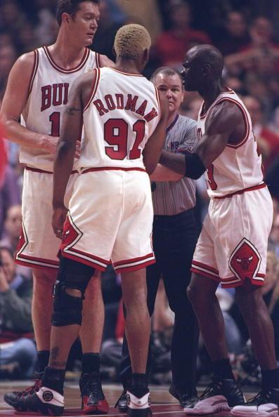 Luc Longley wearing Air Jordan 12s