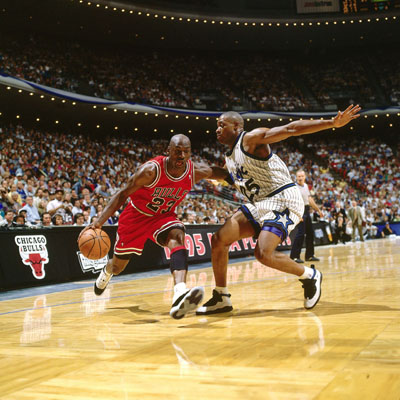 Nick Anderson in Air Jordan 10 guards Michael Jordan in Air jordan 11