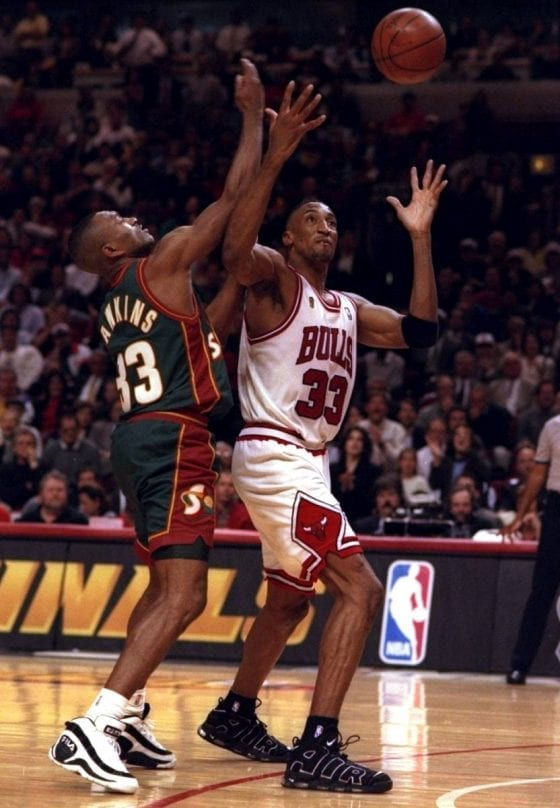 Hersey Hawkins of the Sonics wearing the Fila Muscle Ball vs Scottie Pippen of the Bulls wearing the Nike Air More Uptempo - Fighting for a loose ball - Image via Getty