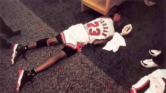 Memorable picture of Michael Jordan crying in the locker room while holding Game ball. image via SC