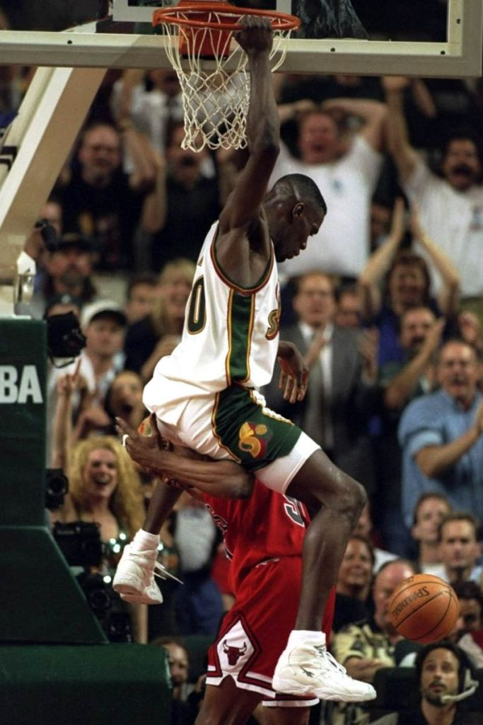 Shawn Kemp of the Sonics, wearing the Reebok Optix, Dunking over Dennis Rodman, of the Bulls Image via Getty