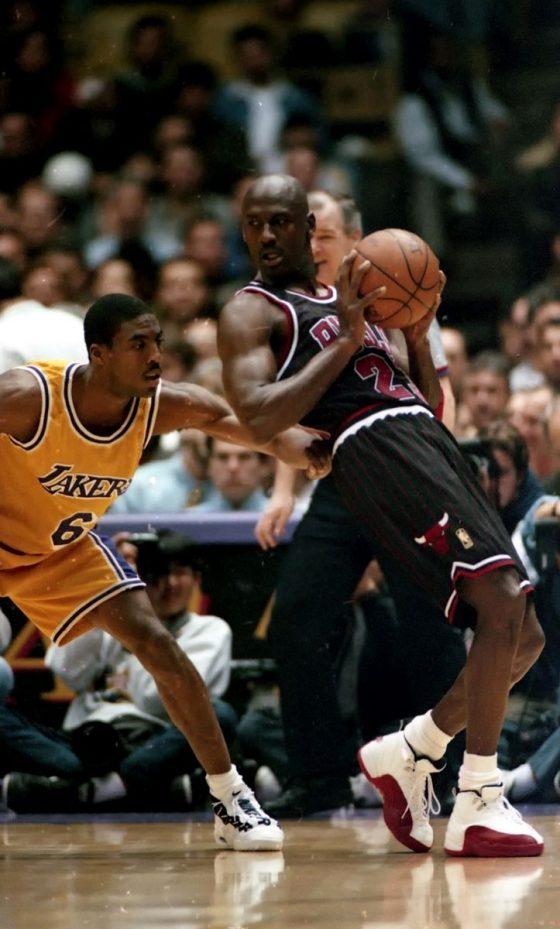 Eddie Jones in Nike Air Money vs Michael Jordan in Air Jordan XII - Image via Pintrest