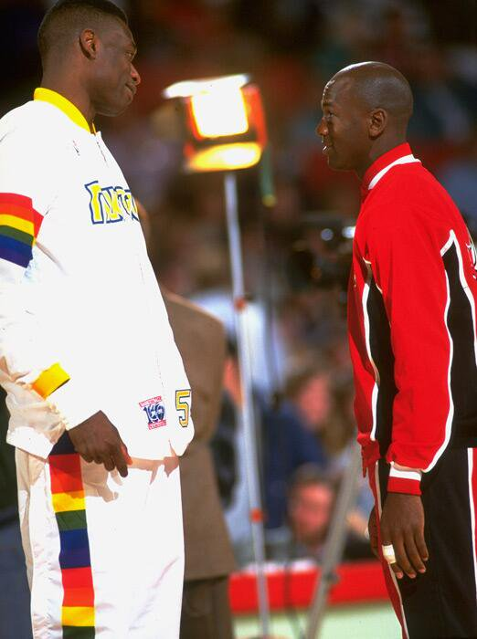 Dikembe Mutombo and Michael Jordan