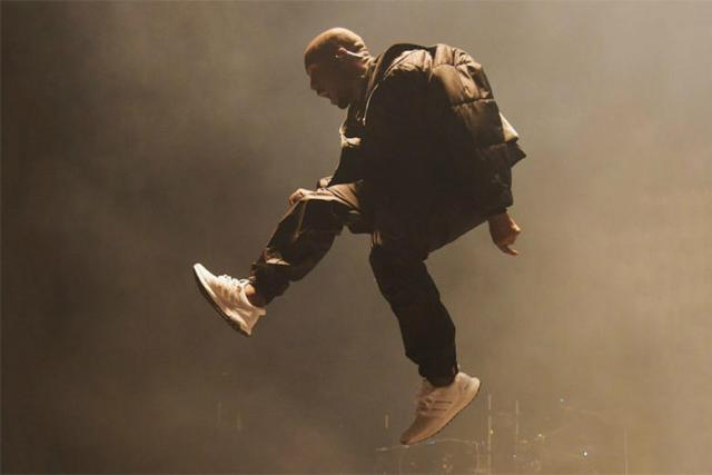 https---hypebeast.com-image-2015-05-kanye-west-rocks-the-new-adidas-ultra-boost-triple-white-during-bbma-performance-1