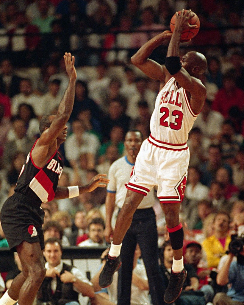 Michael Jordan wearing the Air Jordan 7 Charcoal Playoffs Raptors