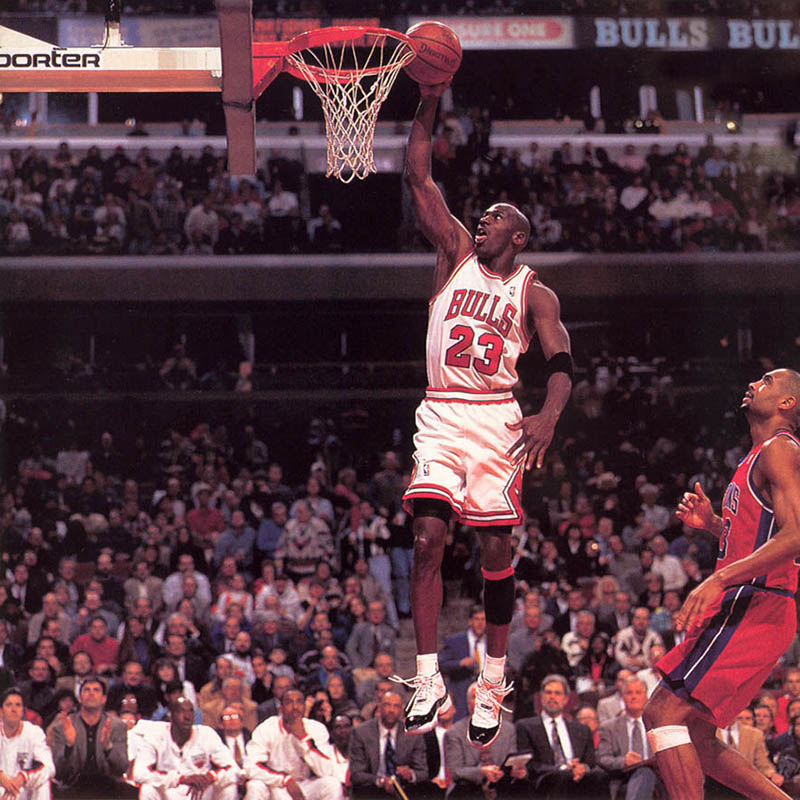 Michael Jordan dunks against Grant Hill while wearing the Air Jordan 11 Concords