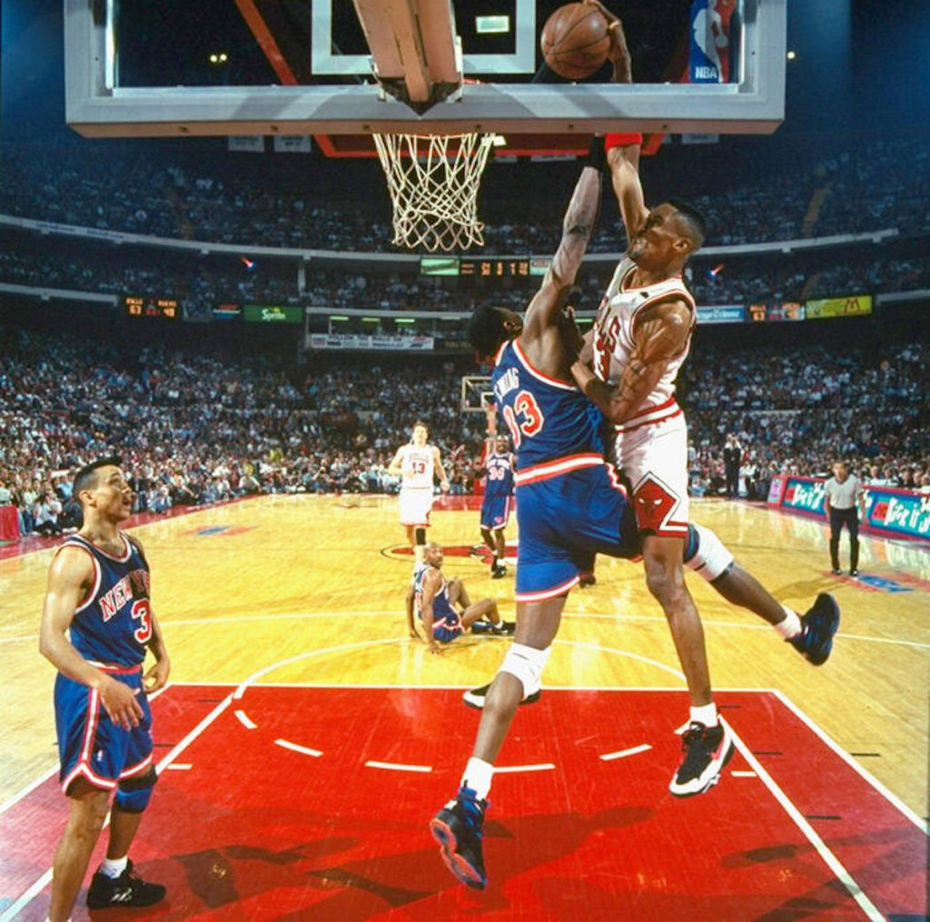 Scottie Pippen dunks on Patrick Ewing while wearing the Nike Air Swift