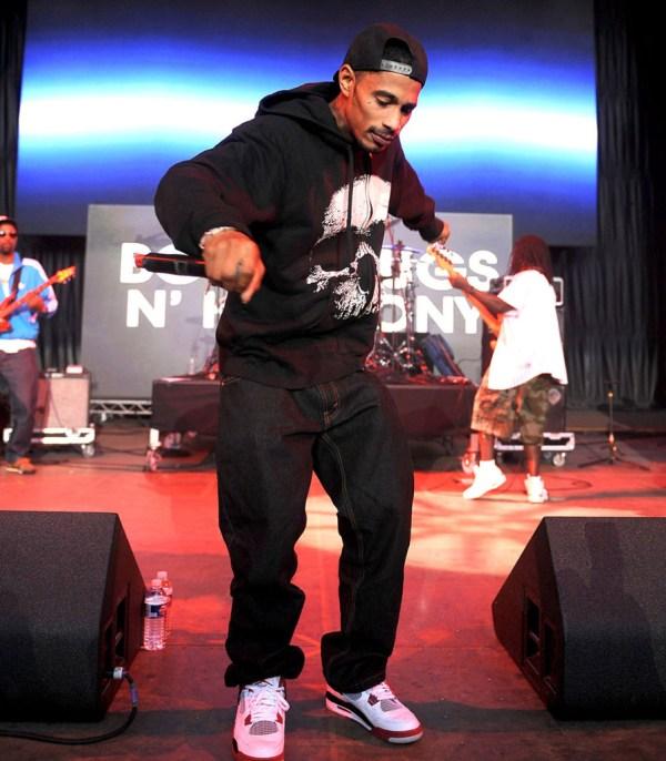 Layzie Bone of Bone Thugs N Harmony in the Air Jordan 4 Fire Red