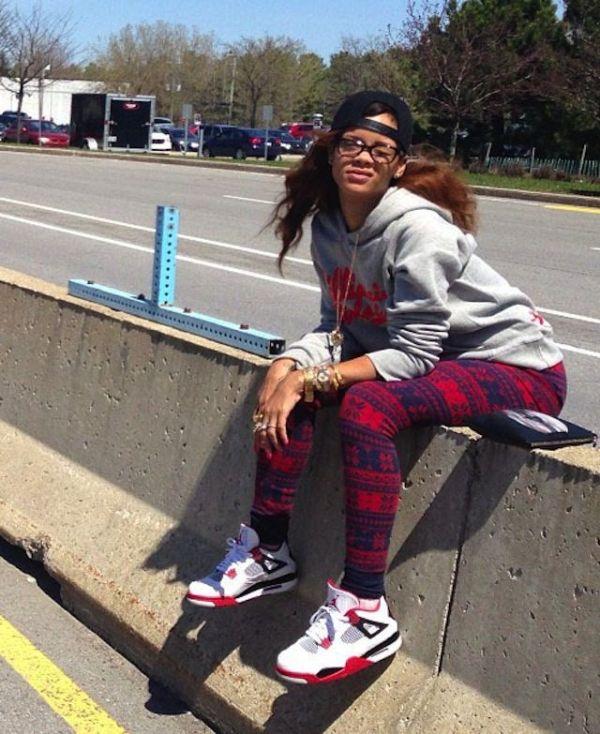 Rihanna wearing the Air Jordan 4 Fire Red