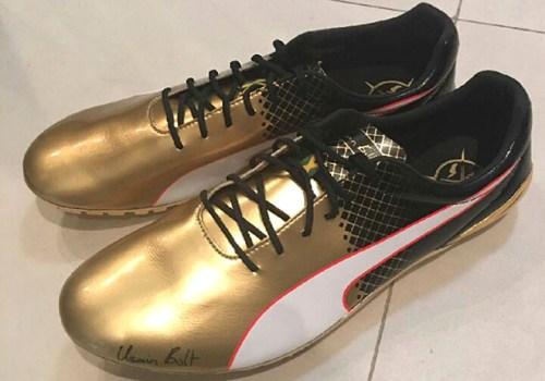 puma-usain-bolt-gold-spikes-100m-01