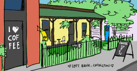 "An illustration of the side exterior of Left Bank Cafe in Covington, Kentucky. Nearer to us we see a door that has I [heart] Coffee on it, and a sidewalk sign that says ""Coffee, Open."" There is a red brick building, a little yellow building with a porch and green roof. Lots of grass, trees, and shrubs. The far part of the yard is blocked off by a little white building."