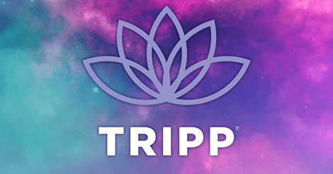 """The Tripp Game Logo. The background is a colorful universe and the logo itself is a stylized lotus blossom with the word """"tripp"""" under it in all capital letters."""