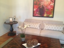 Client warm eclectic living room with art as focal point