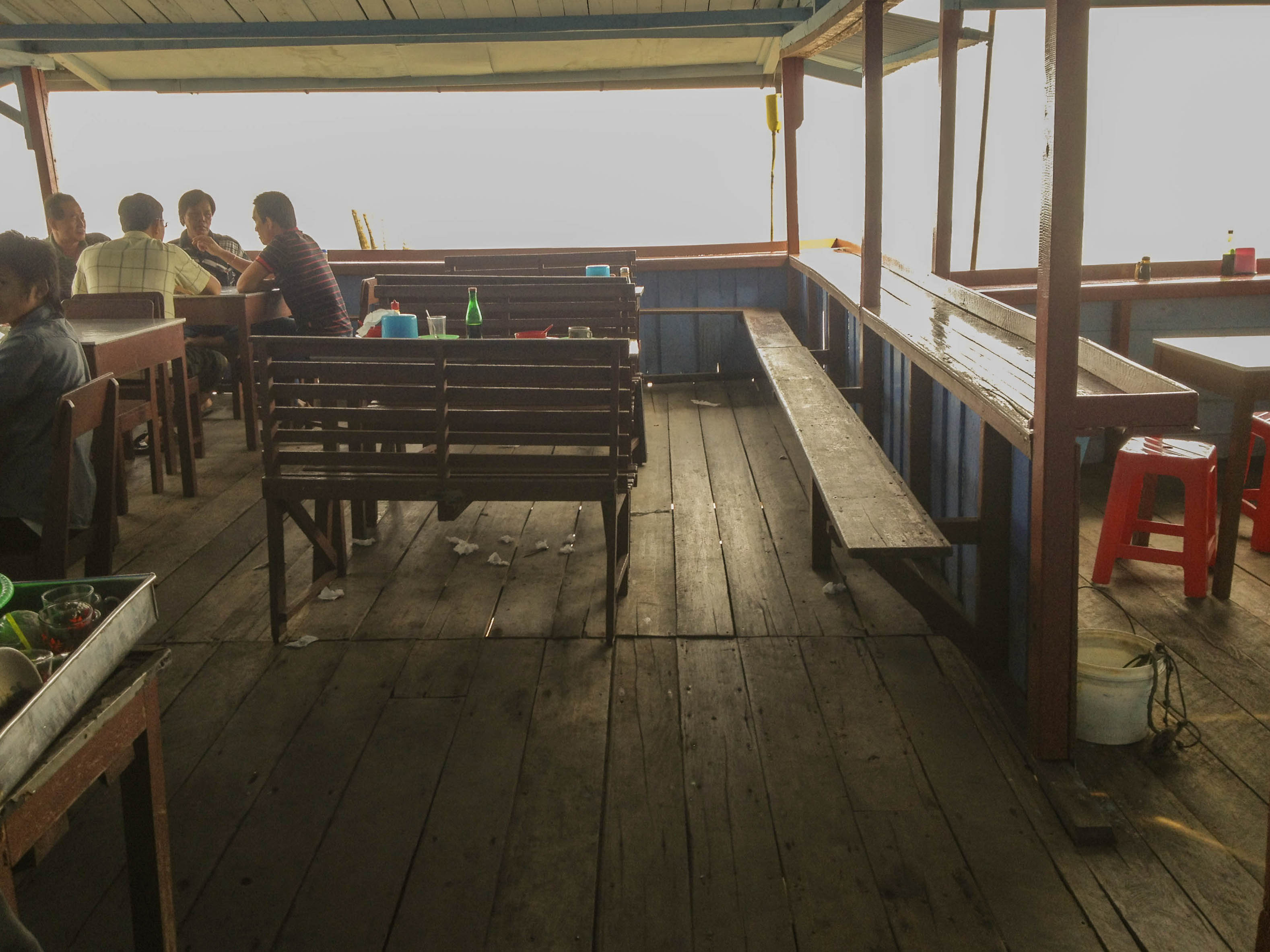 One of the coffee shops that is on top of the sea. It was held with planks of wood so that they could stay above water.