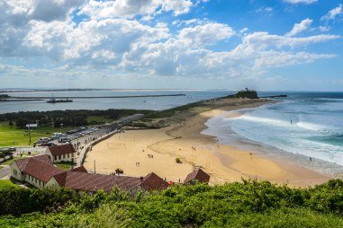 View from the top of Fort Scratchley, overlooking Nobbys Beach and lighthouse
